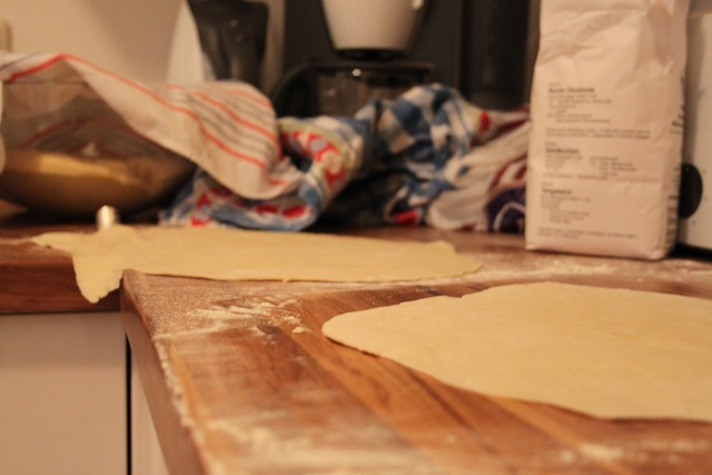 rolling out pizza dough (Eat Me. Drink Me.)