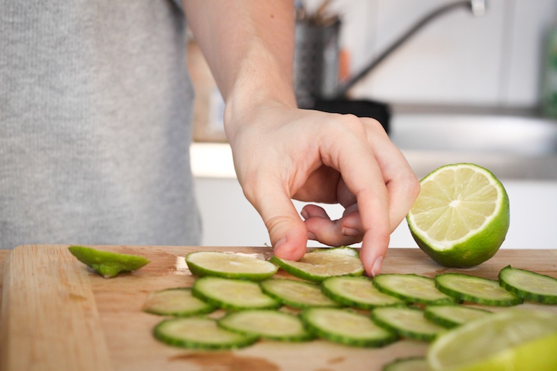 Ellen slices cucumbers (Eat Me. Drink Me.)