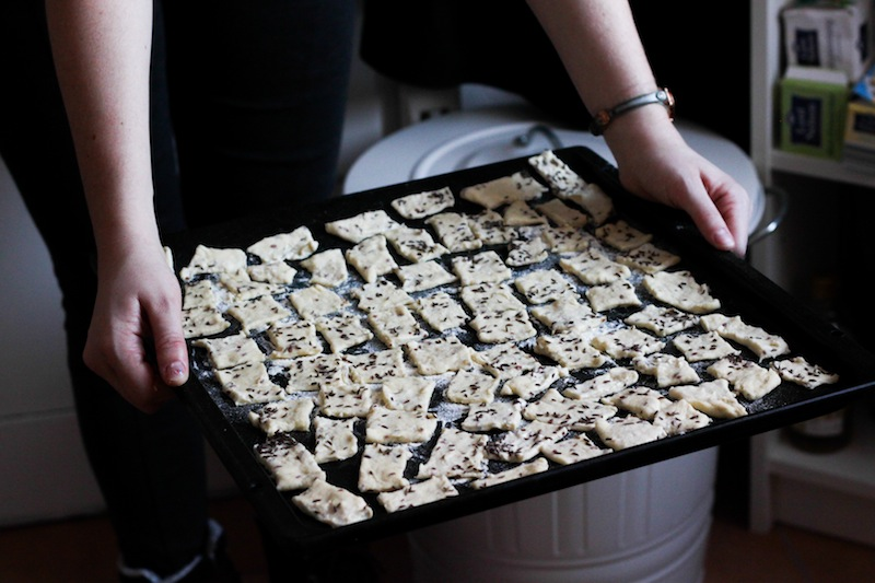 A tray of homemade crackers (Eat Me. Drink Me.)
