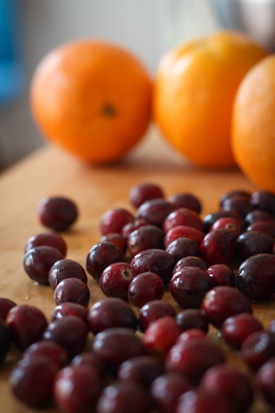 Fresh cranberries and oranges (Eat Me. Drink Me.)