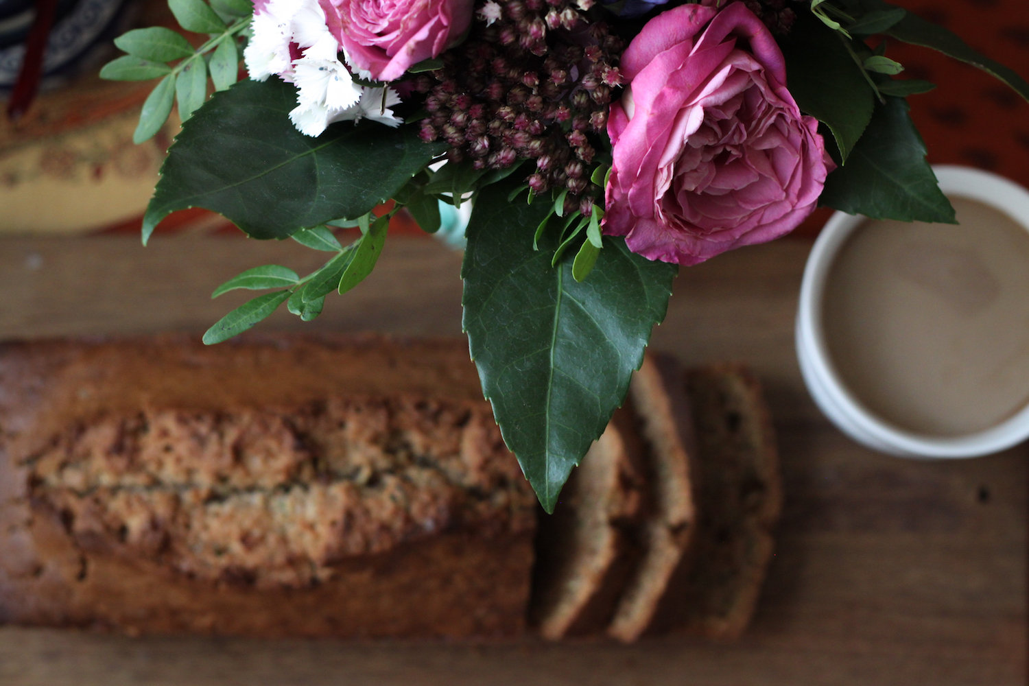 Still life with zucchini bread, flowers, and coffee (Eat Me. Drink Me.)