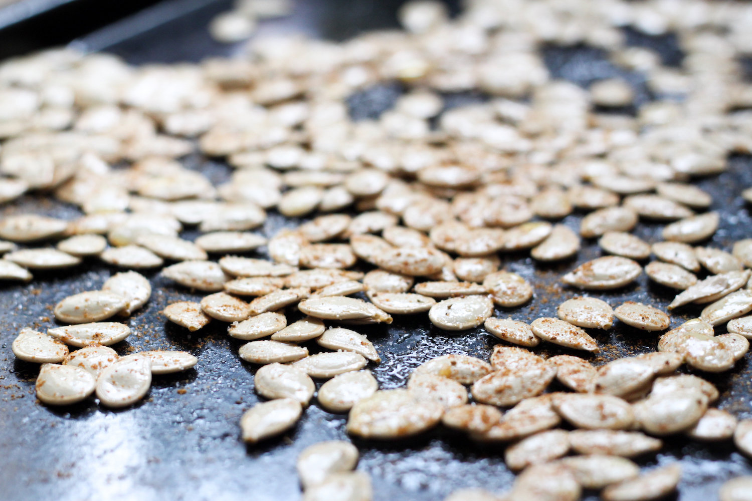 Roasting pumpkin seeds with Old Bay (Eat Me. Drink Me.)