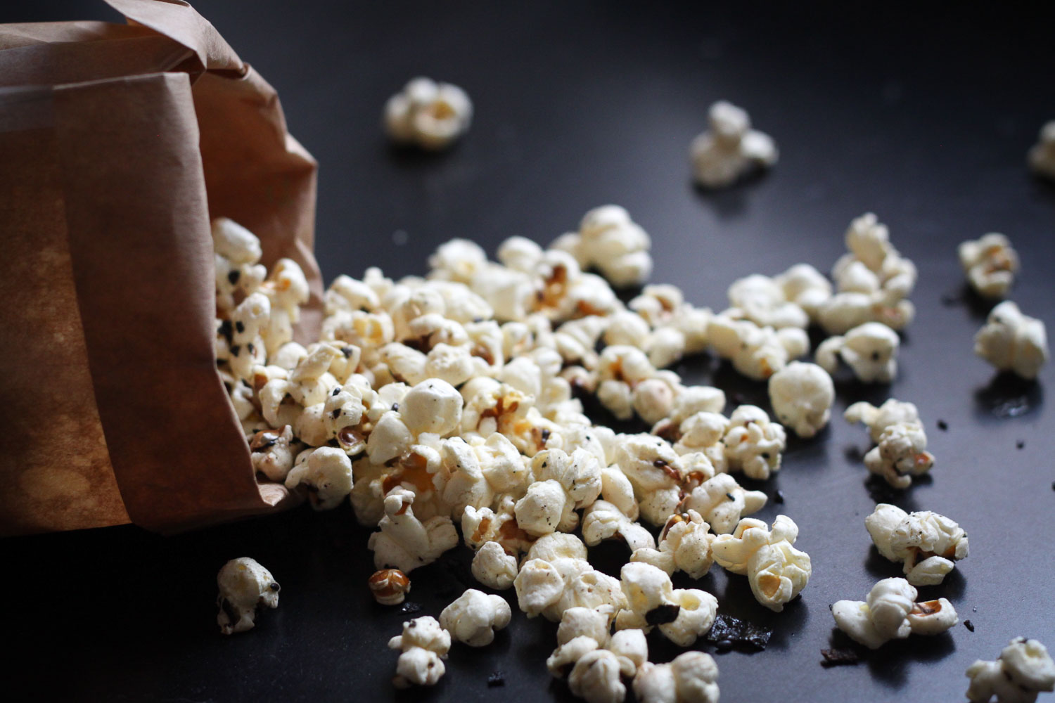 Spilled popcorn for snacking (Eat Me. Drink Me.)