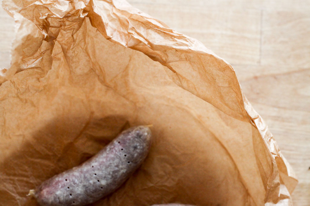 Bratwurst in wax paper (Eat Me. Drink Me.)