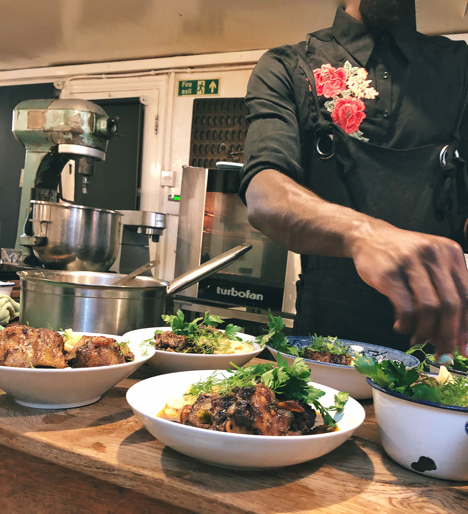 Garnishing the oxtail (photo courtesy of Counter Service)
