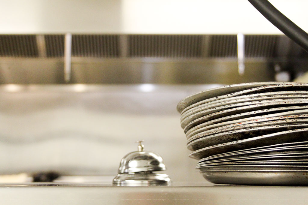Metal plates in the kitchen (Eat Me. Drink Me.)