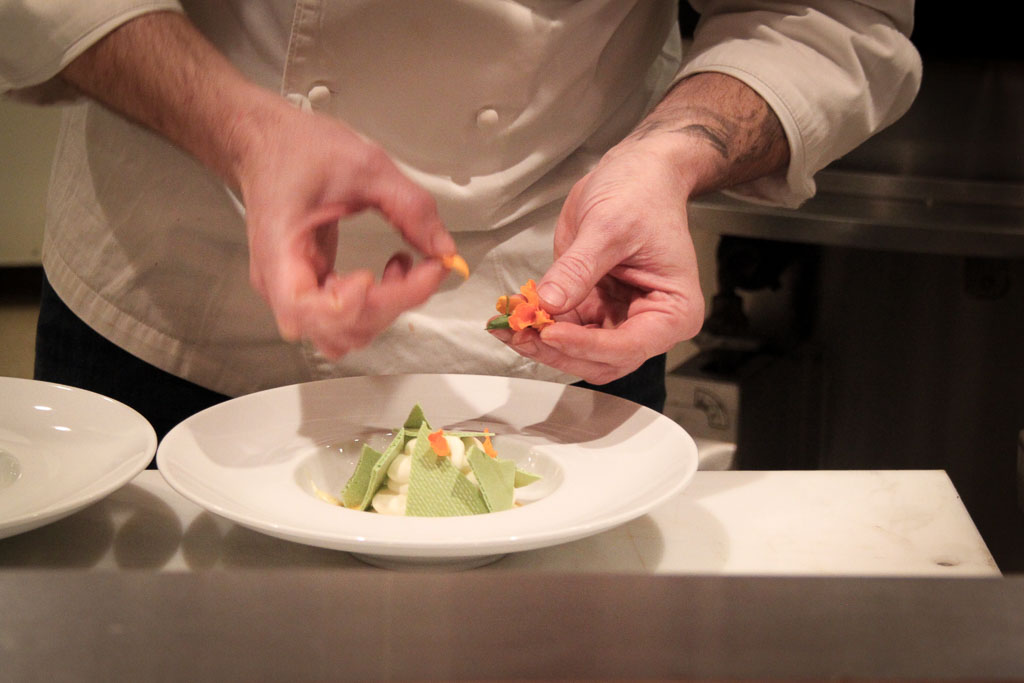 Chef Enrique Limardo plating dessert (Eat Me. Drink Me.)