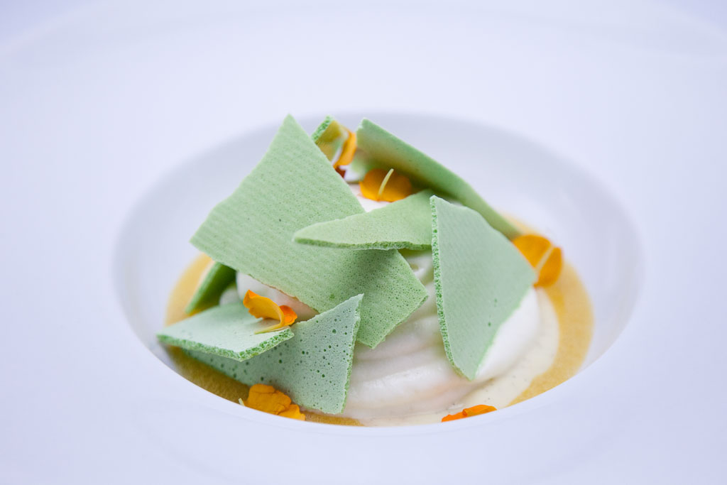 White chocolate foam, passion fruit, and pistachio meringue (photo courtesy of alma cocina latina)