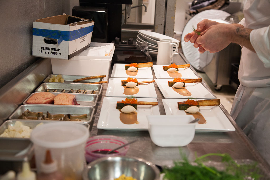Enrique Limardo plating the first course (photo courtesy of alma cocina latina)